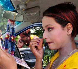 Donne al volante, make-up costante