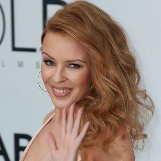 Kylie Minogue e Chris Martin sorpresi mano nella mano