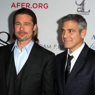 Brad Pitt incontra il neo papà George Clooney