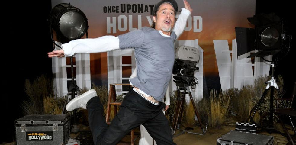 Il photobomb divertentissimo di Brad Pitt a Margot Robbie